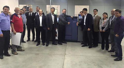 Executivos das equipes da Konica Minolta  e da ANS